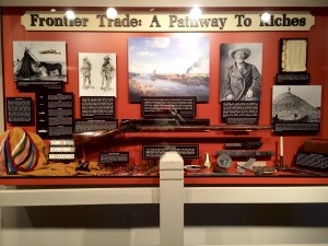 An assortment of beads, traps, guns, and other trade goods on display at the Arabia Steamboat Museum in Kansas City
